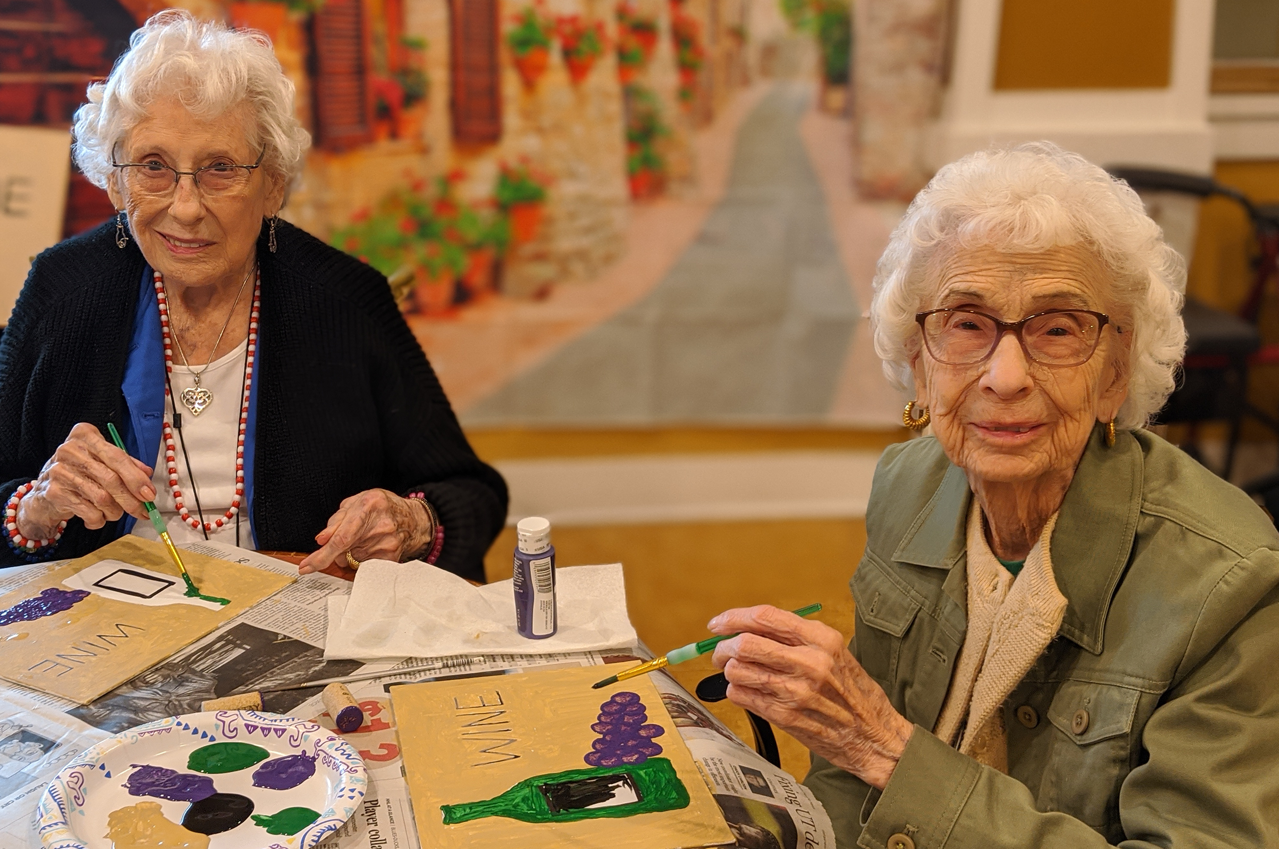 two seniors enjoying crafting