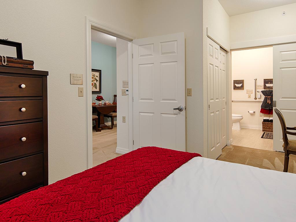 Bedroom leading to Living Room and Bathroom