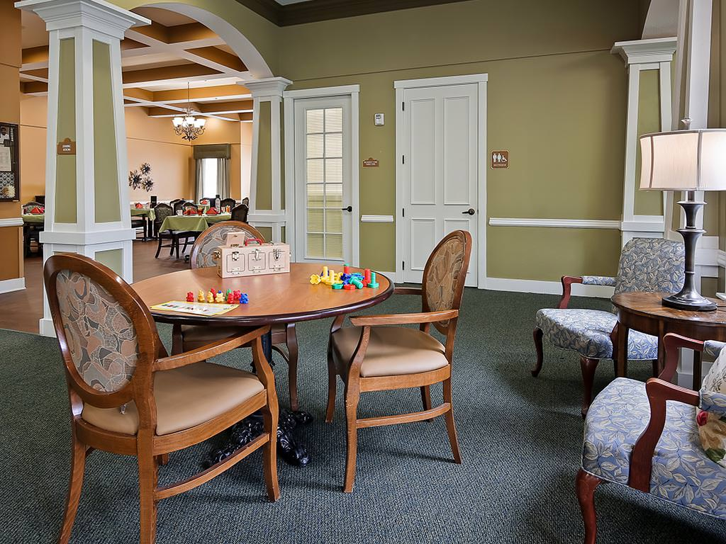 Casual Seating and Game Table leading to the Dining Room
